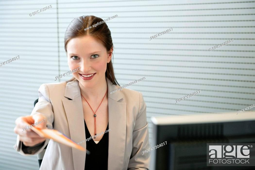 Stock Photo: Businesswoman giving an envelope.