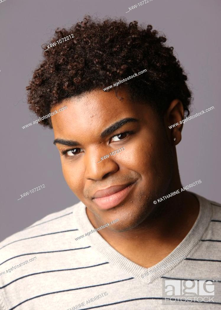 Stock Photo: Young African-American man posing for portrait.