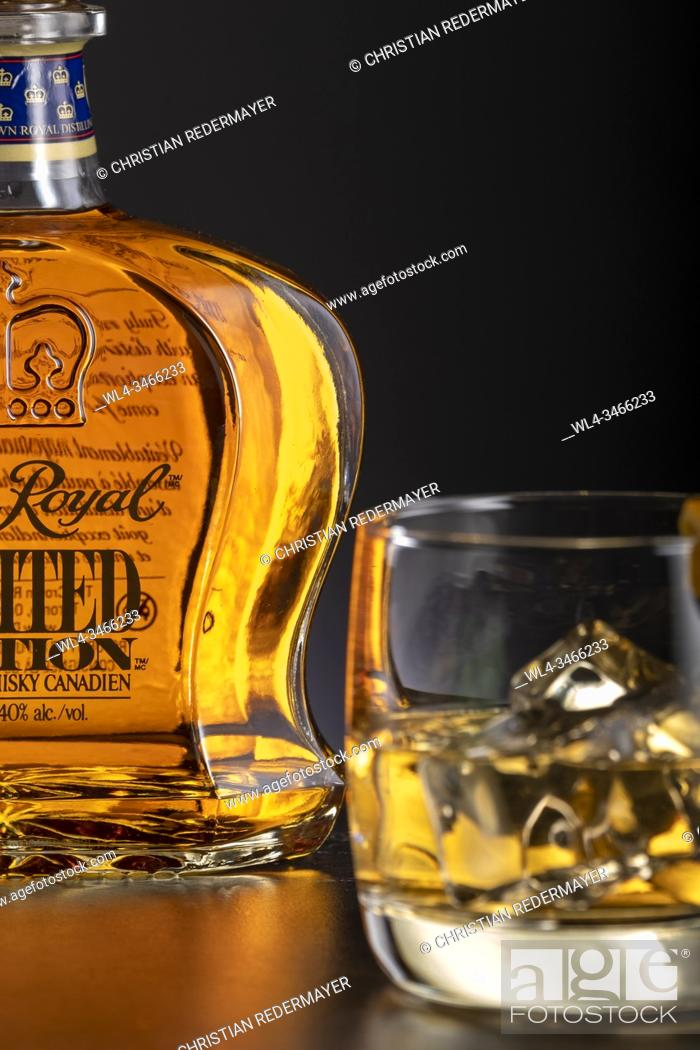 Stock Photo: Close - up from Whiskey bottle and a glass.
