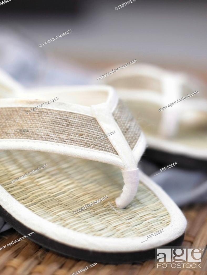 Stock Photo: White flip-flops made of straw.