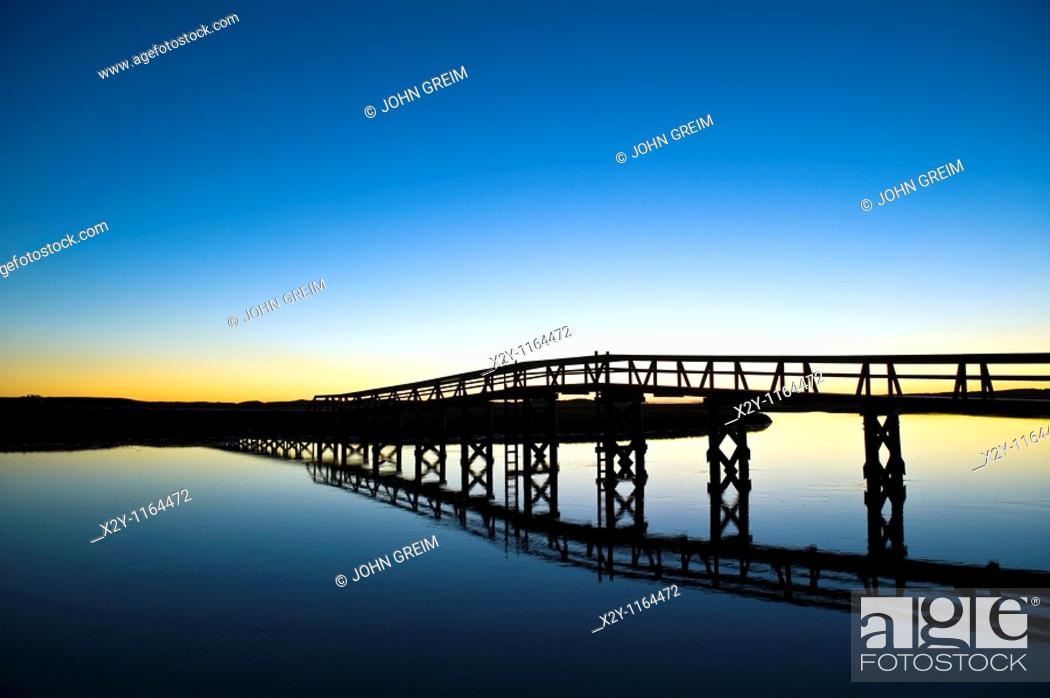 Stock Photo: Boardwalk extending over the salt pond and marsh to the beach, Sandwich, Cape Cod.