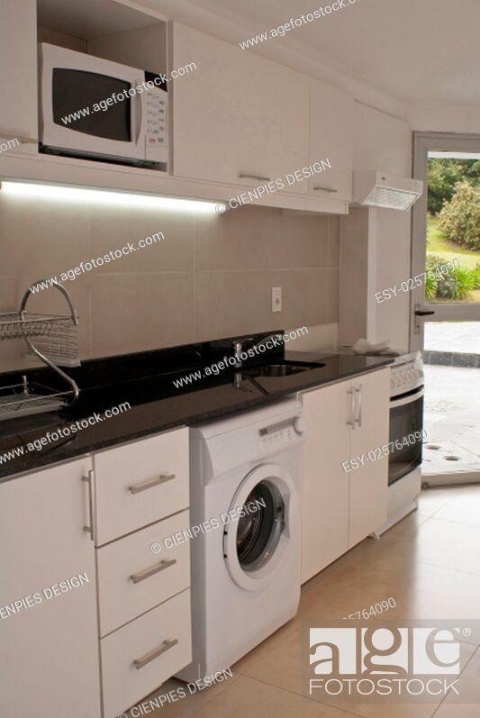 Stock Photo: Modern style kitchen interior design with outdoor garden view.