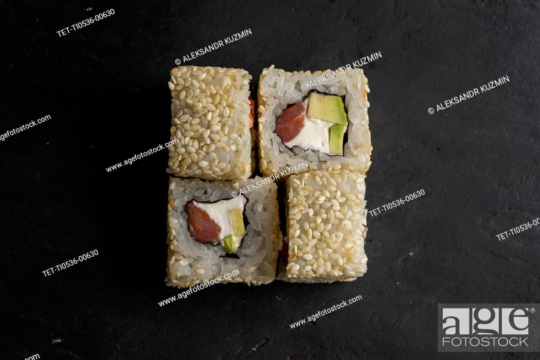 Stock Photo: Sushi with sesame seeds on black surface.