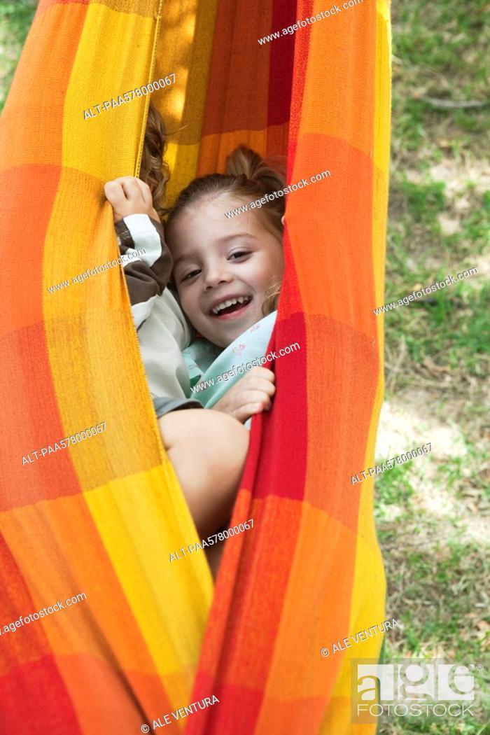 Stock Photo: Children hiding together in hammock.