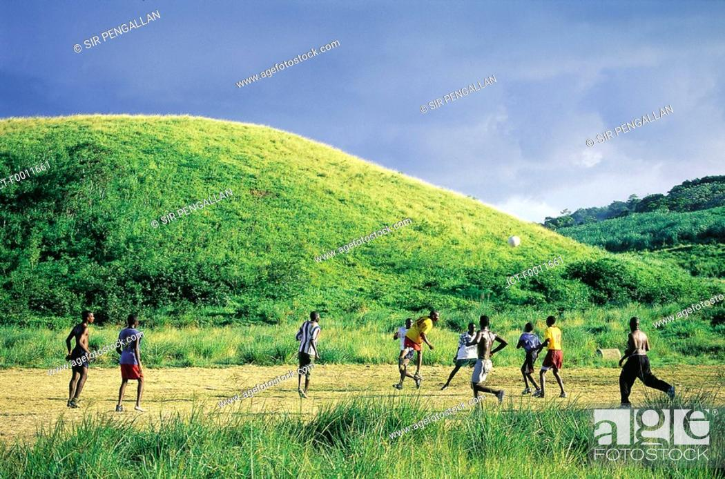 Stock Photo: Jamaica, Golden Grove vicinity, playing rural football.