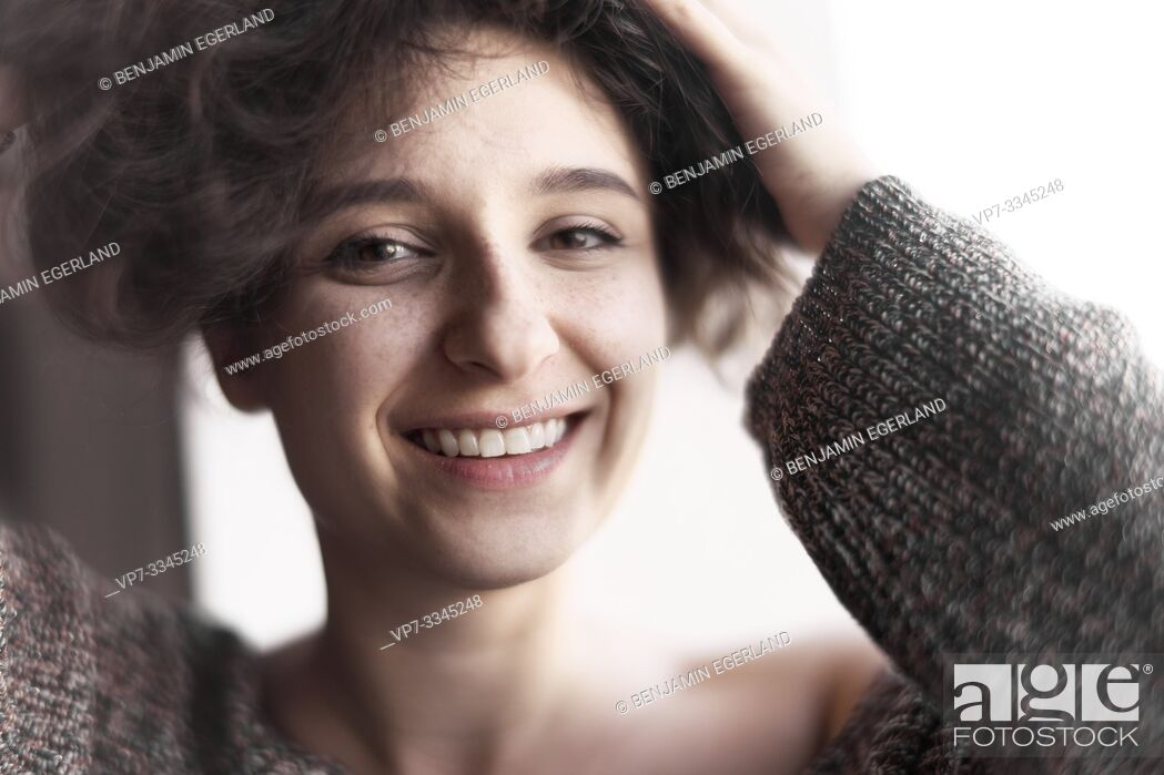 Stock Photo: young happy woman.