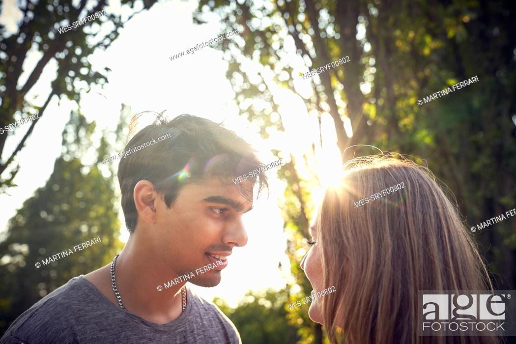 Stock Photo: Happy young couple flirting in a park in summer.