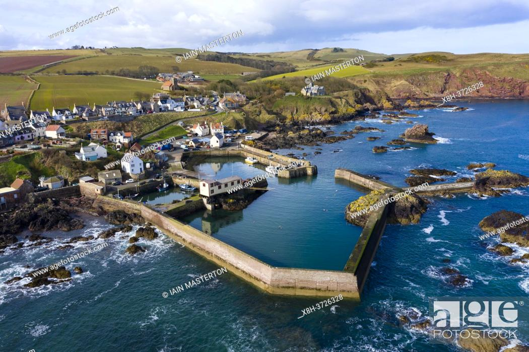 Stock Photo: Aerial view of small fishing village and harbour of St Abbs on North Sea coast in Scottish Borders, Scotland, UK.