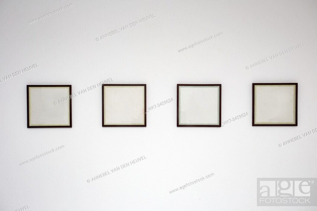 Stock Photo: Blank black picture frame template for place image or text inside on the white wall in a row close-up.