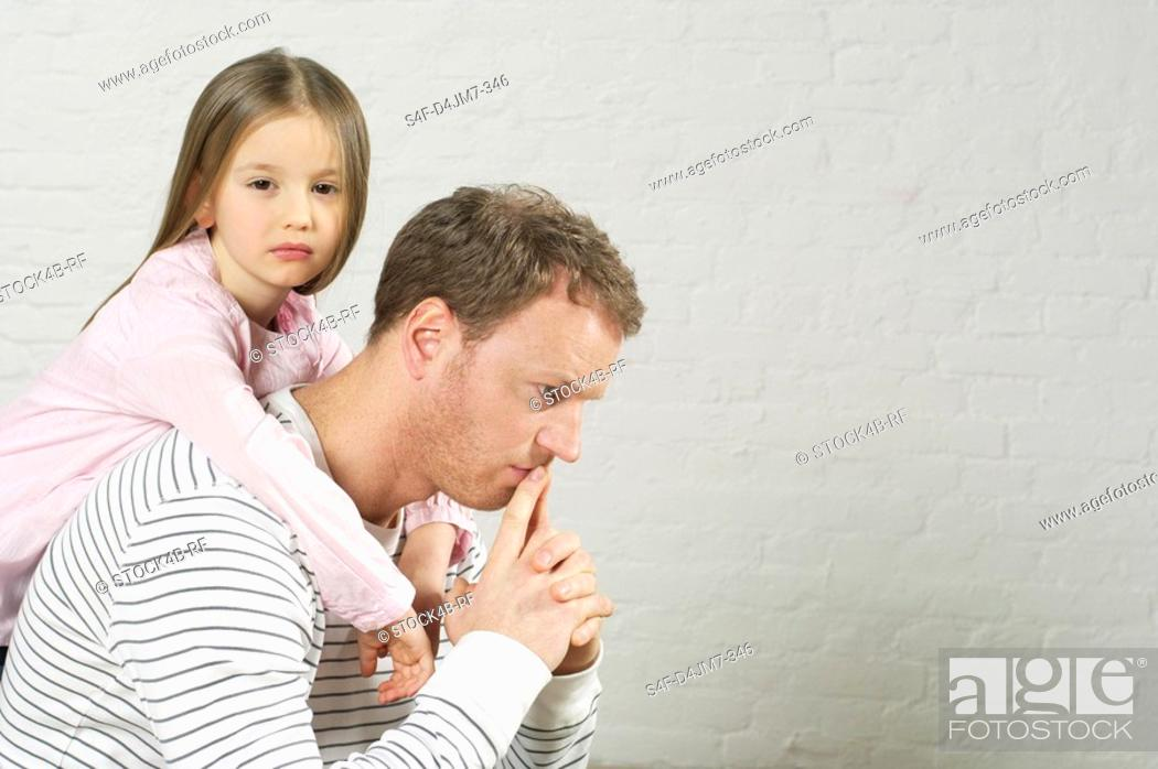 Stock Photo: Girl embracing reflective father from behind.