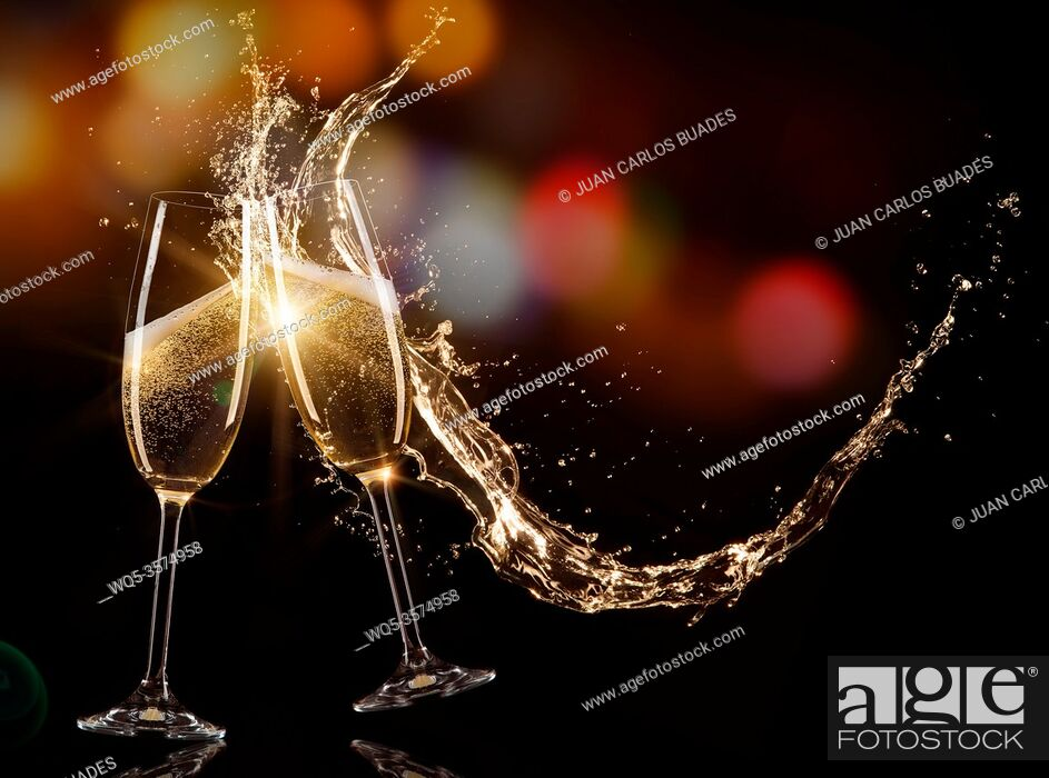 Stock Photo: Glasses of champagne with splash, isolated on black.