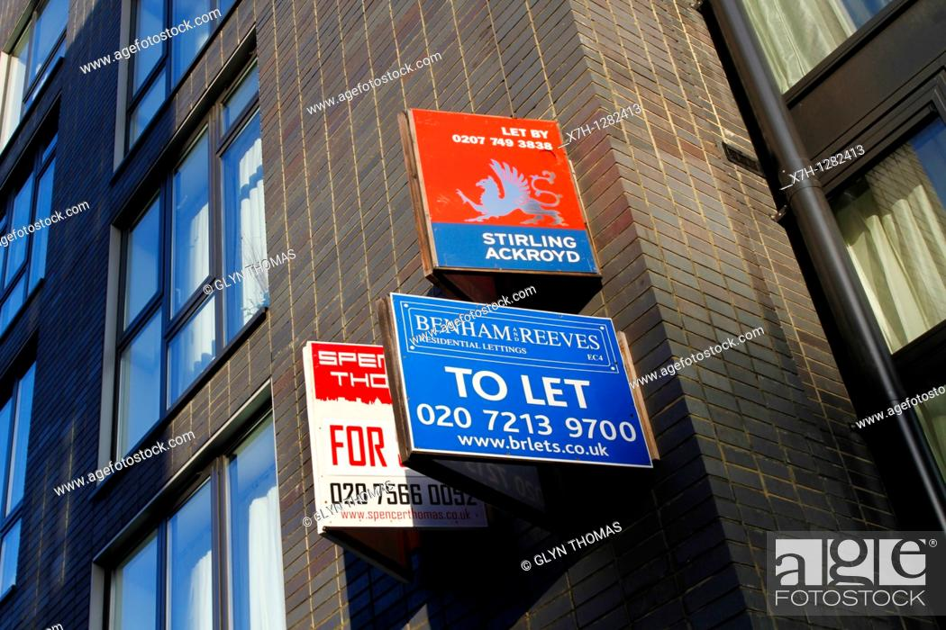 Stock Photo: For sale and to let signs outside a block of apartments.