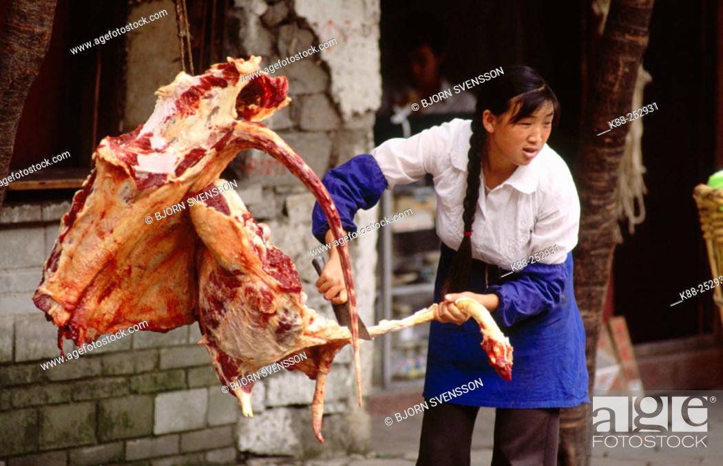 Stock Photo: Lady butcher in Dali. Yunnan. China.