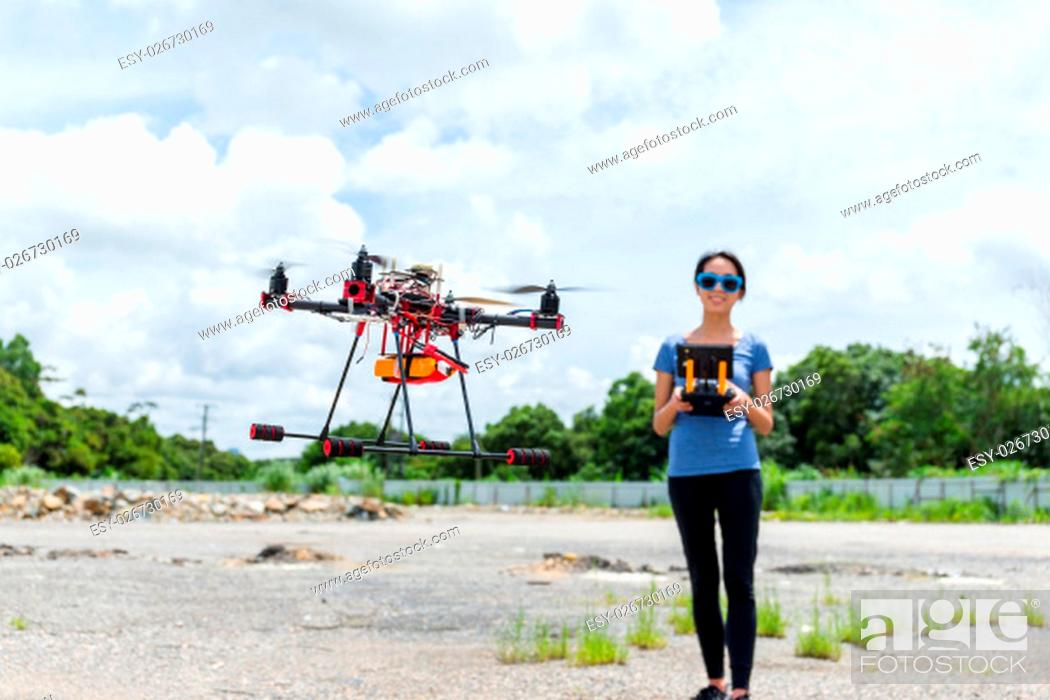 Stock Photo: Woman control the drone.