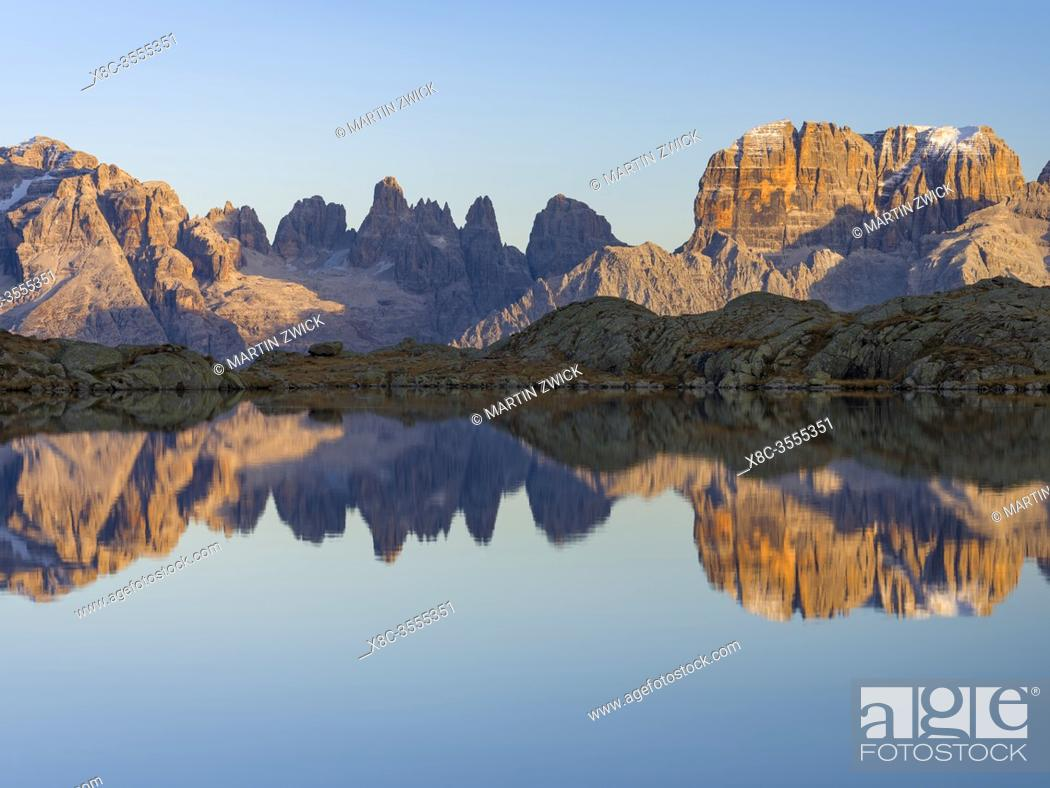 Stock Photo: The summits of Brenta mountain range are reflected in Lago Nero. Brenta group in the Dolomites, part of UNESCO world heritage The Dolomites.