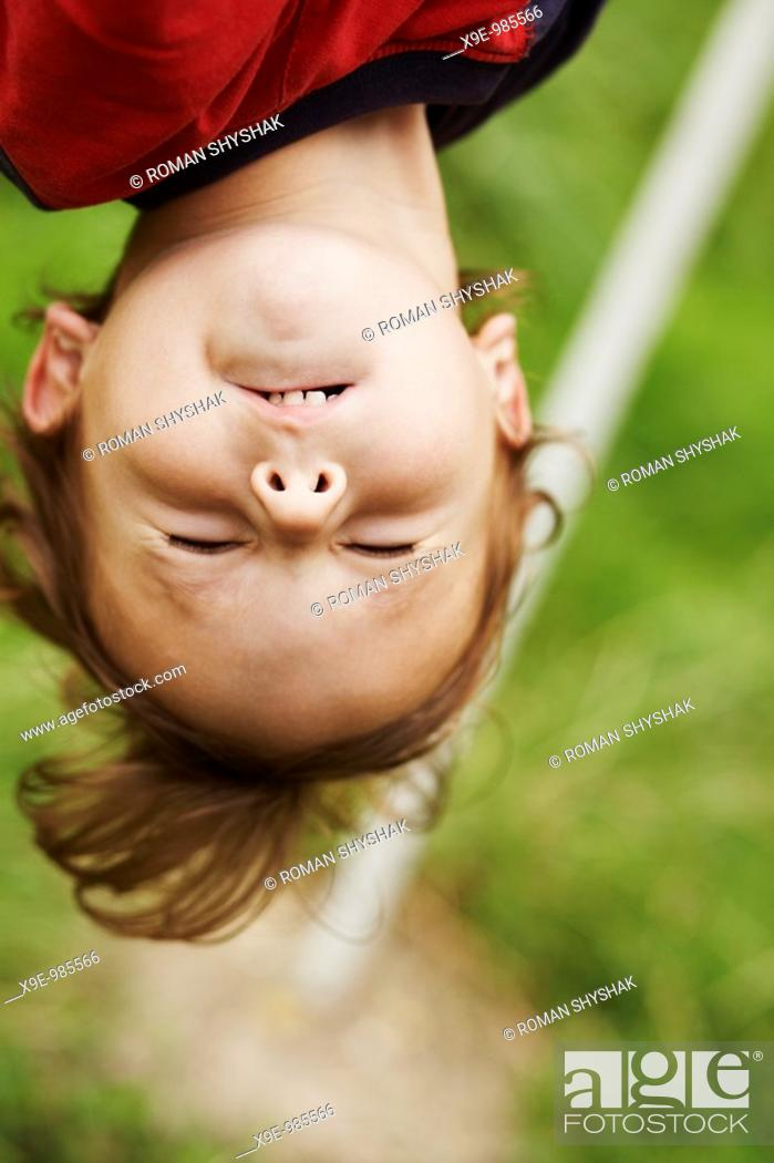 Stock Photo: A closeup picture of the head who is hanging upside down.