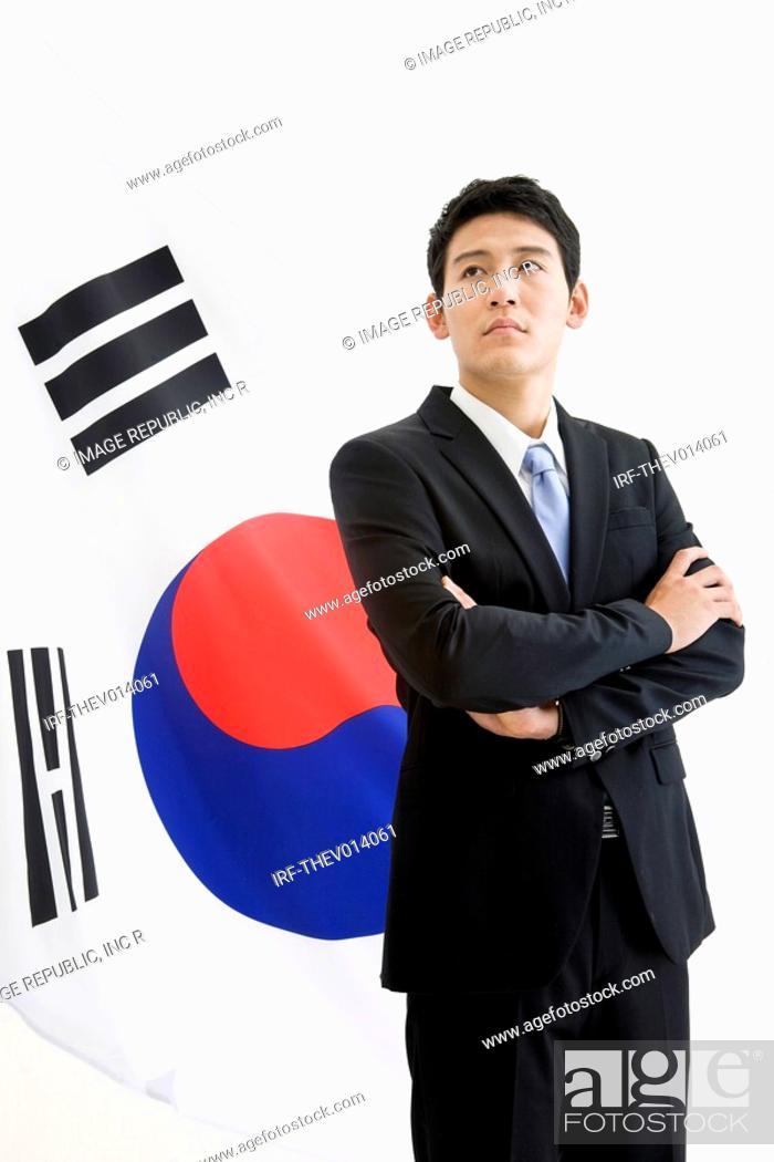 Stock Photo: businessman in front of Korean flag, Taegeukgi.