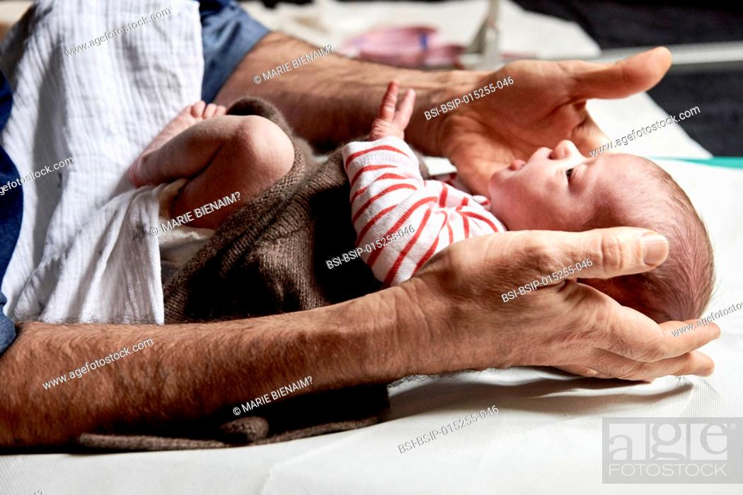 Stock Photo: Reportage on a midwife in Lyon, France. Consultation with a 2-week old baby.