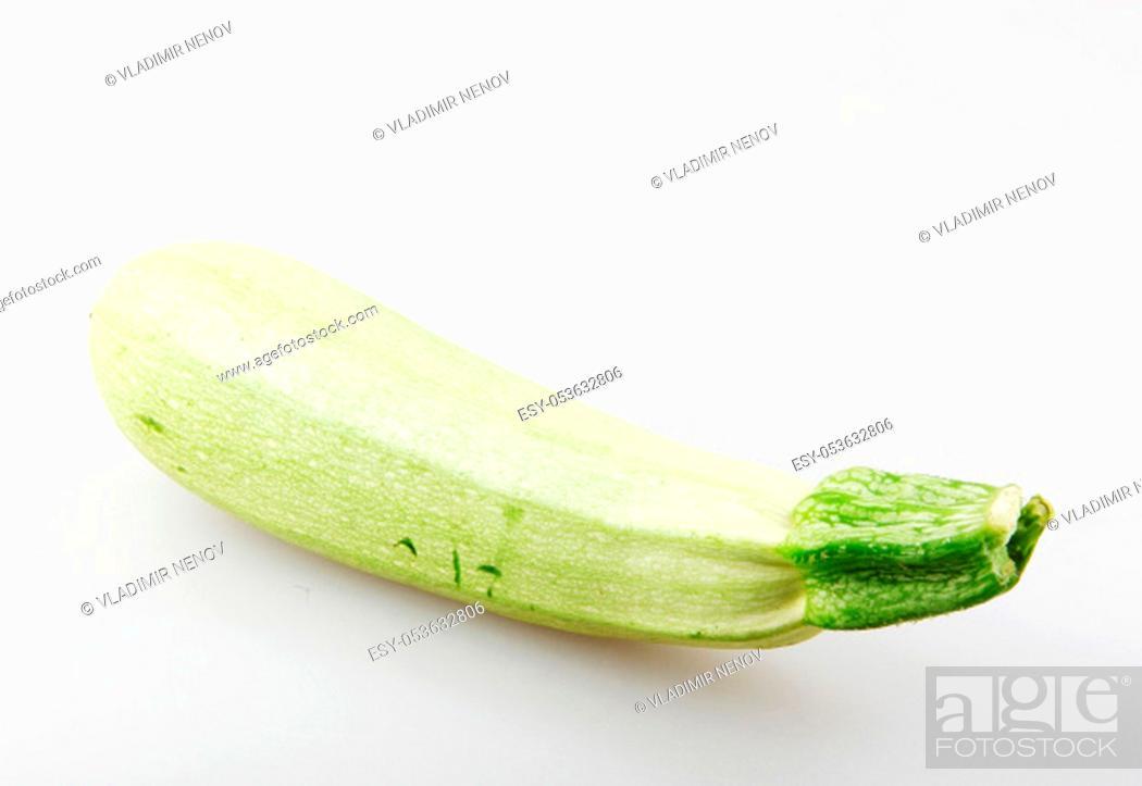 Stock Photo: Fresh Vegetable Zucchini Against White Background.