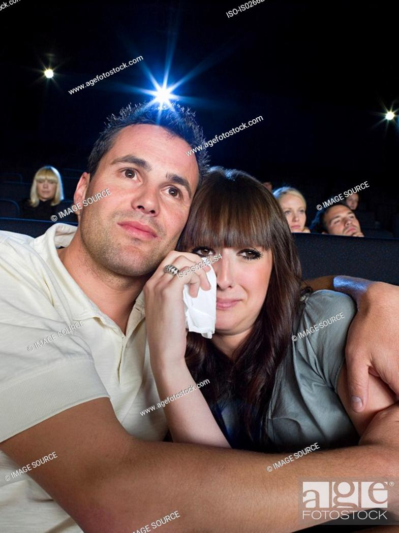 Stock Photo: A man comforting a woman watching a sad movie.