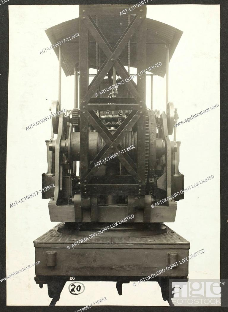 Stock Photo: Photograph - A.T. Harman & Sons, Front View of a Rail-Mounted Excavator, circa 1923, One of three black and white photographs attached to an album page.