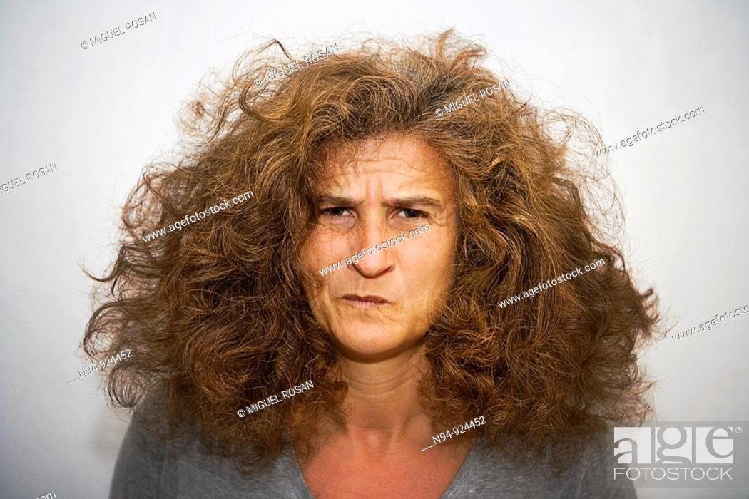 Stock Photo: Disheveled woman with an expression of pain.