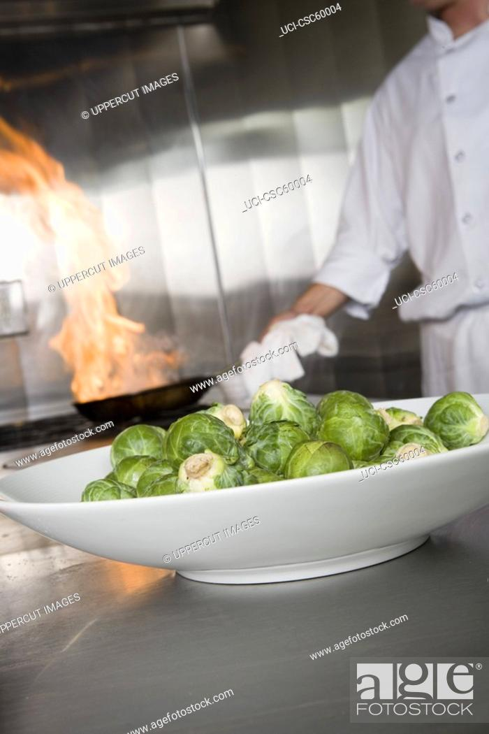 Stock Photo: Plate of brussels sprouts in kitchen.
