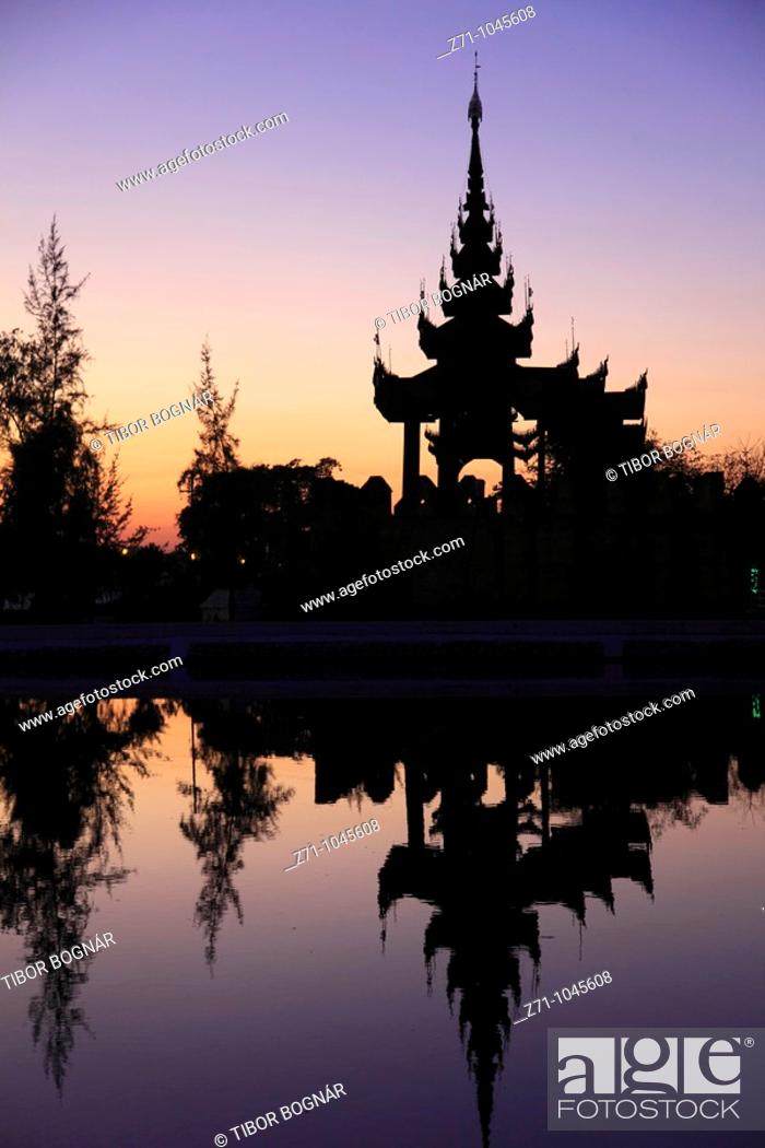 Stock Photo: Myanmar, Burma, Mandalay, Palace, moat, watchtower silhouette, sunset,.
