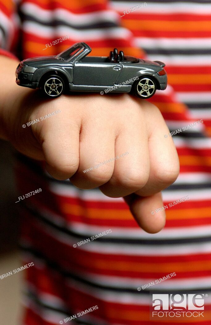 Imagen: Boy With Toy Car On His Fist.