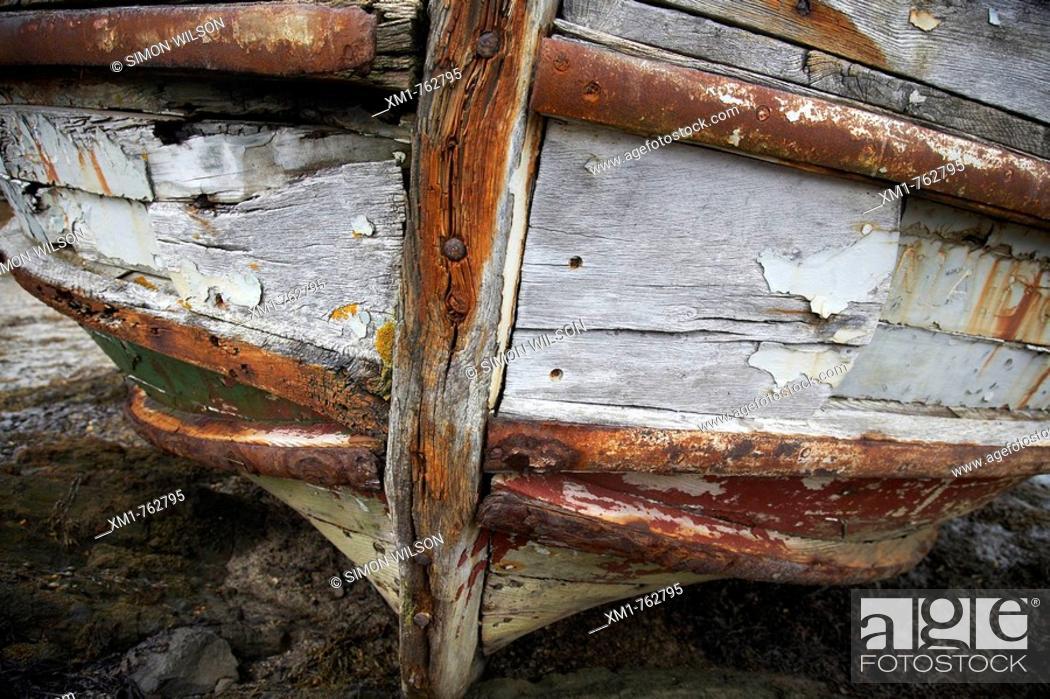 Stock Photo: Shipwreck on rocks, on a beach.