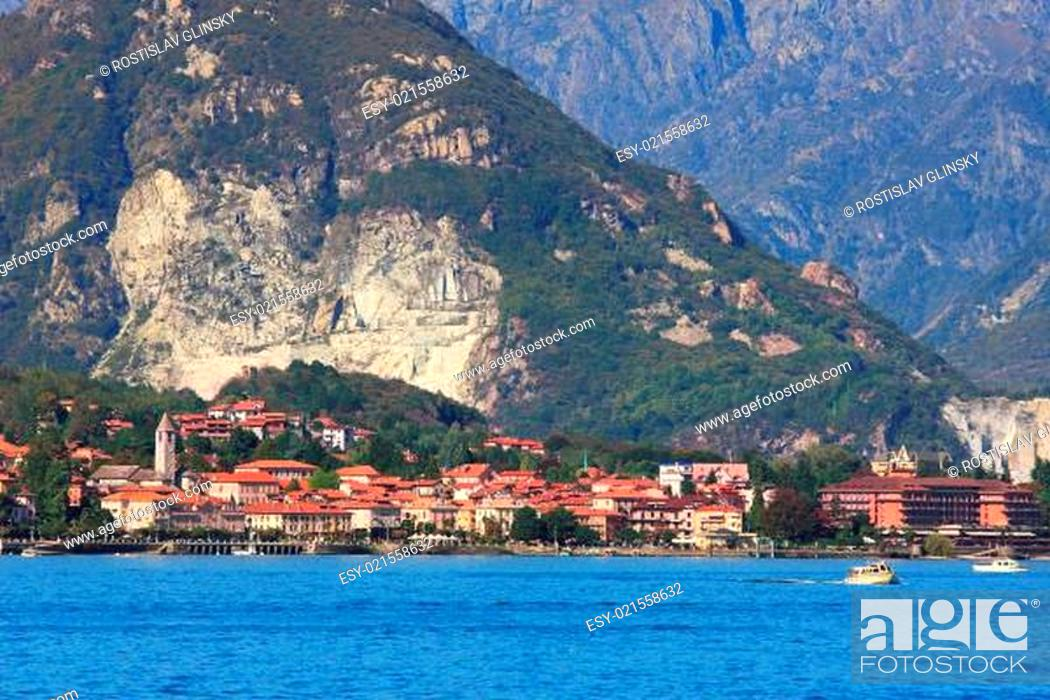Stock Photo: Small town on lake Maggiore and mountains on the background in Northern Italy.