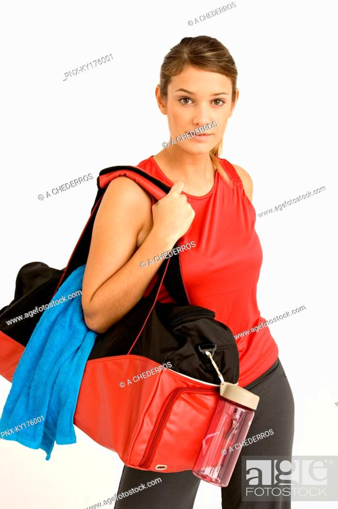 Stock Photo: Portrait of a young woman carrying a gym bag.