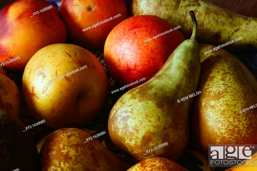 Stock Photo: Plate of fruit  Apples, nectarines,pears.