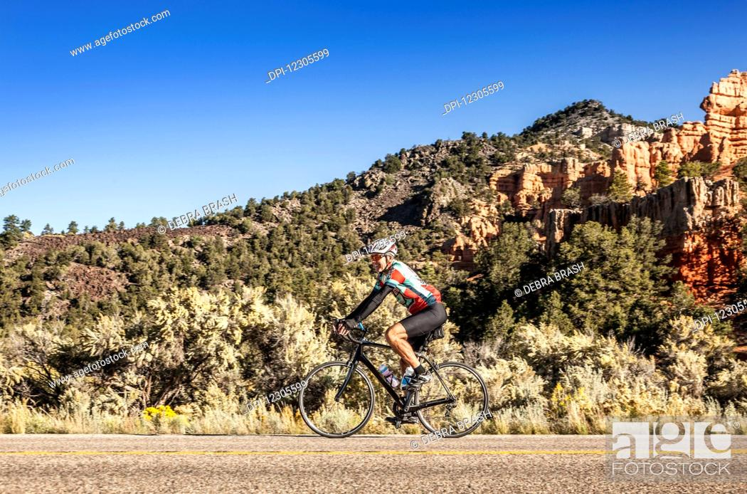 Stock Photo: A senior man cycles in Zion Nation Park; Utah, United States of America.
