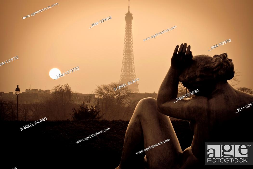 Stock Photo: Eiffel Tower and sculptures at sunset from Tuileries Garden  Paris, France.