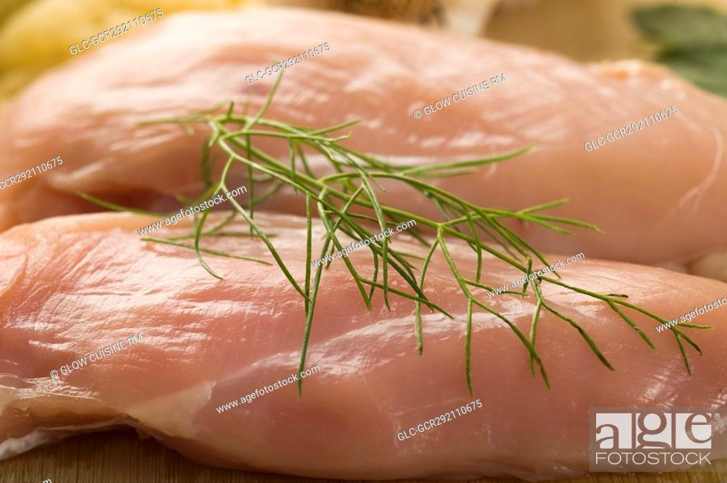 Stock Photo: Close-up of raw chicken with herb.