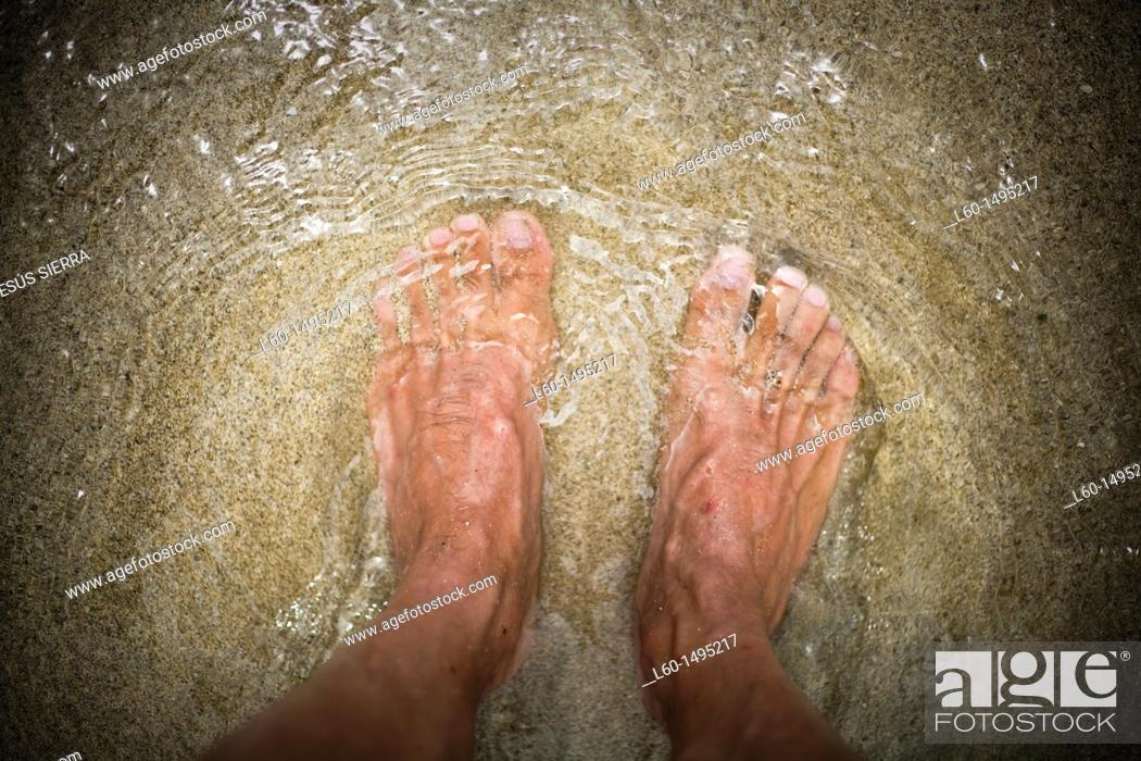 Stock Photo: Feet in beach  Cabo de Gata, Almeria, Spain.