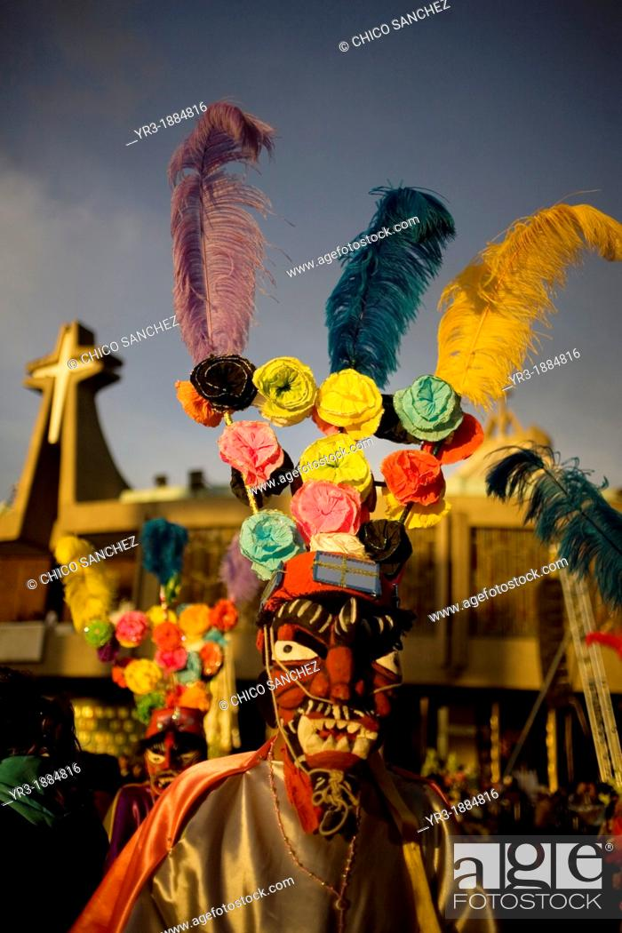 Stock Photo: A pilgrim from Tomatlan, Veracruz state, dressed as a red devil performs the Baile de los Santiagos or Saint James's Dance outside of the Our Lady of Guadalupe.