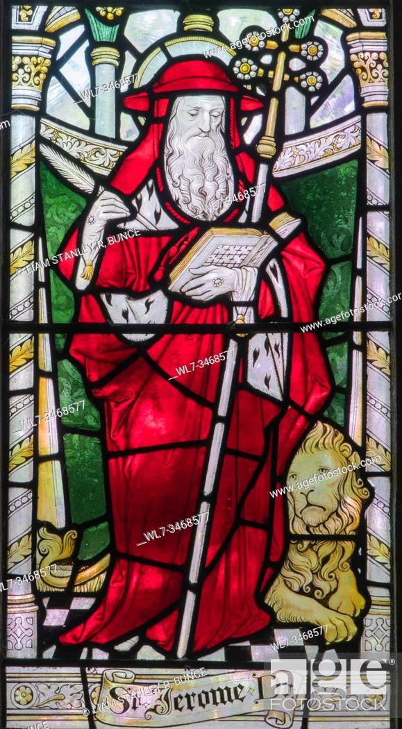 Stock Photo: Stained glass depicting St Jerome a Latin Priest, Chester Cathedral Cheshire UK. May 2019.