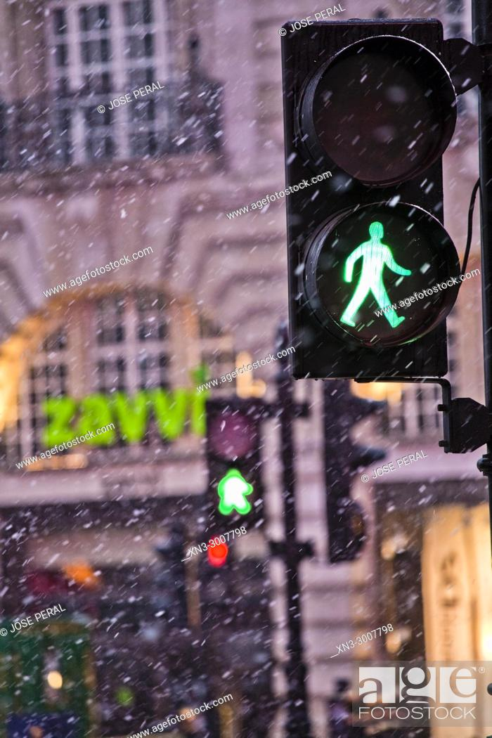 Stock Photo: Snowing, Green traffic light pedestrian, Piccadilly Circus, City of Westminster, London, England, UK, United Kingdom, Europe.