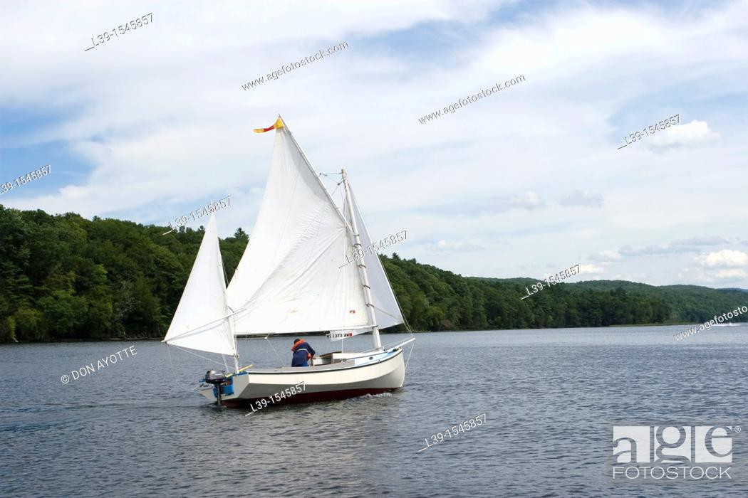 Stock Photo: Cat Boat under sail on the CT river in Turners Falls, MA, USA.