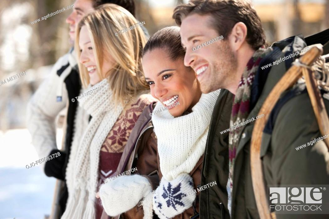 Stock Photo: Smiling couples with sled.