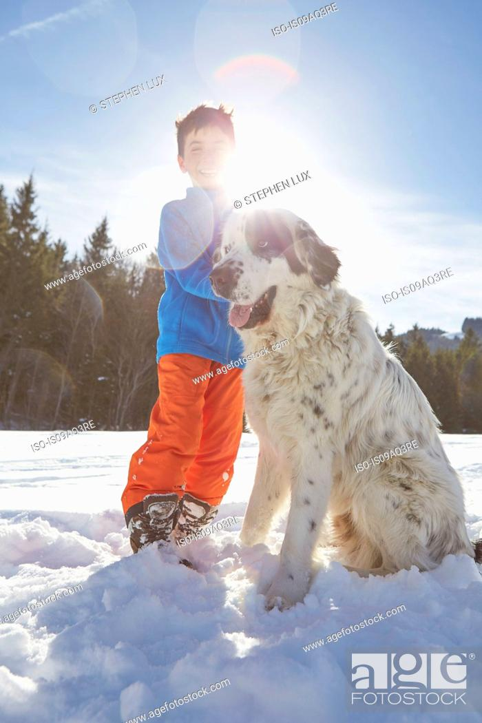 Stock Photo: Boy bonding with his pet dog.