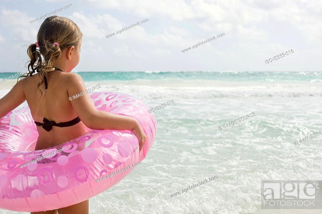 Stock Photo: A girl holding a rubber ring.