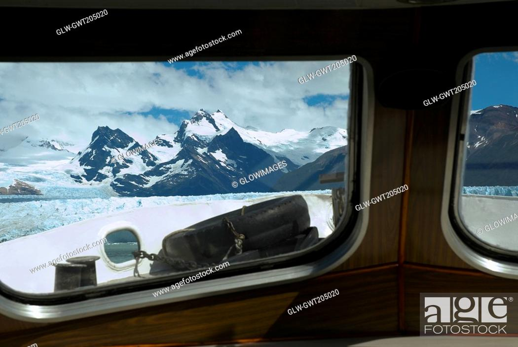 Stock Photo: Mountain viewed through the window of a ship, Lake Argentino, Patagonia, Argentina.