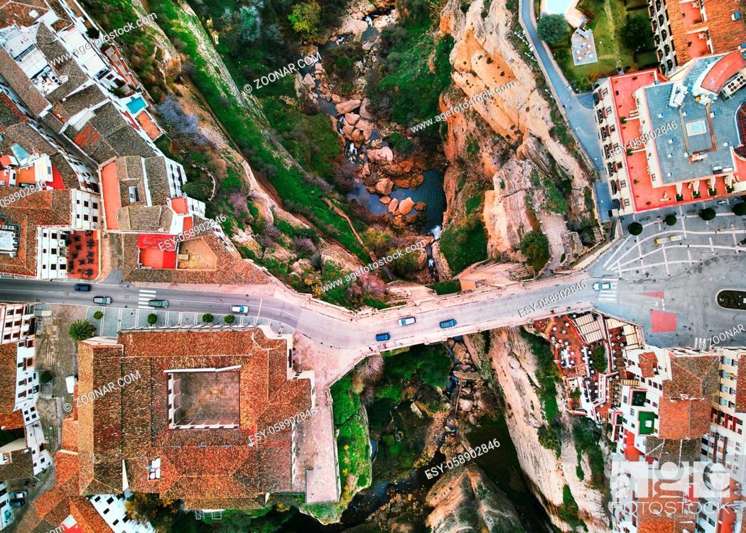 Stock Photo: Pueblo blanco or white village view from above aerial photography Ronda spanish cityscape. New Bridge across Guadalevín river El Tajo gorge, Costa del Sol.