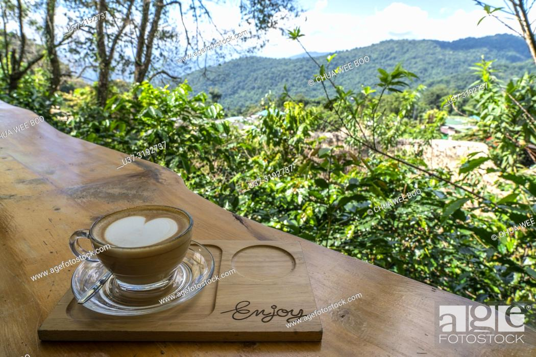 Imagen: Cappucino and hilltop view at Hmong's Hilltribe Village, Doi Pui, Chiang Mai, Thailand.