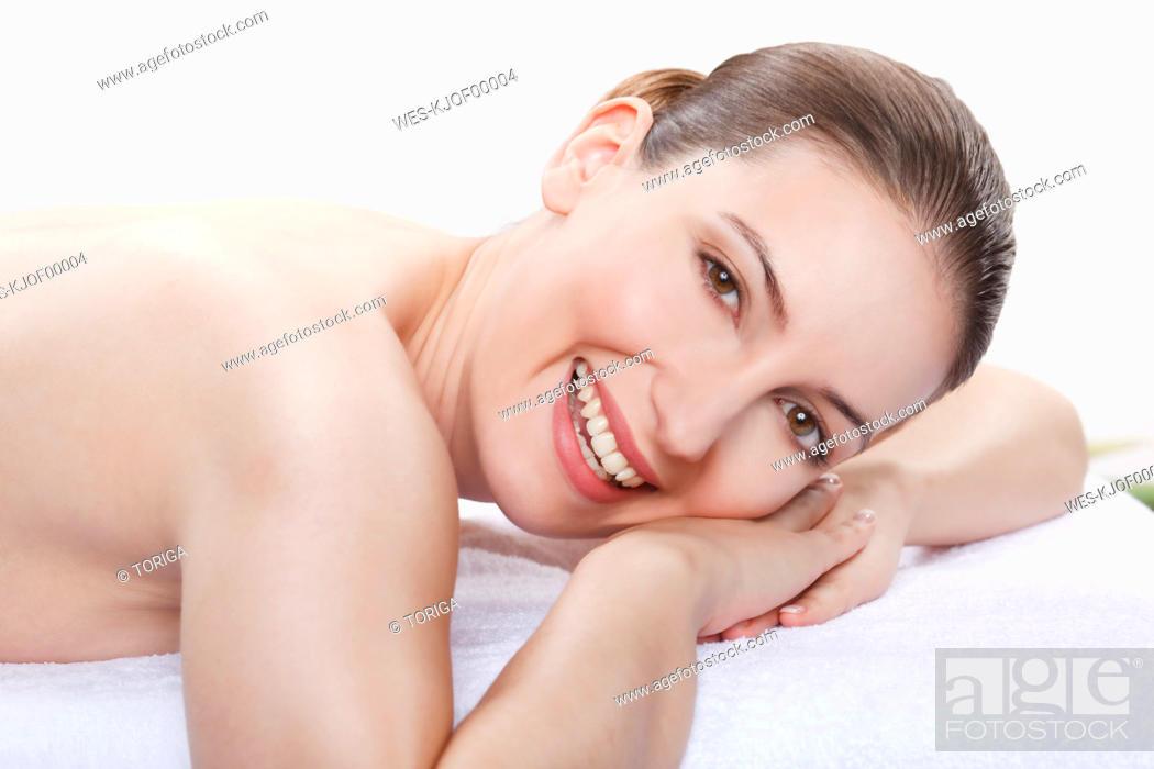 Stock Photo: Woman having a spa treatment, smiling, portrait.