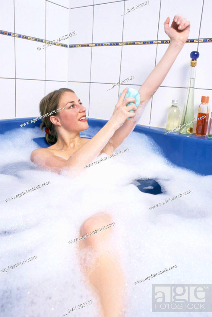 Stock Photo: A young woman, 20-25 25-30 years old, in the bathroom, having a foam bath, bathing.