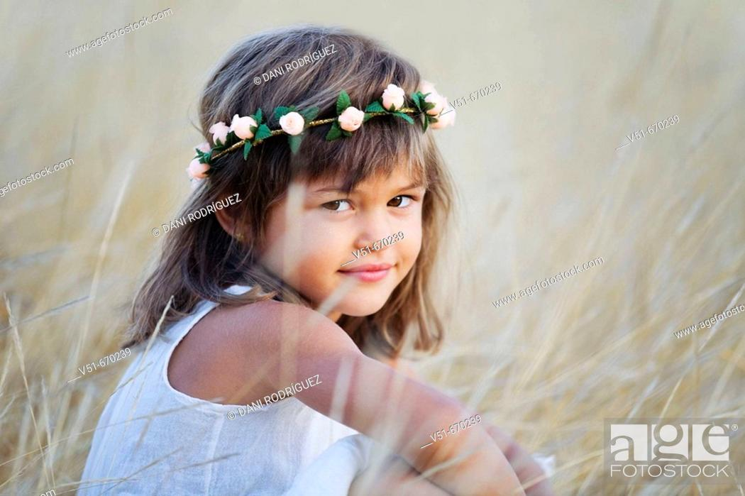 Stock Photo: Young girl looking at camera in the countryside.